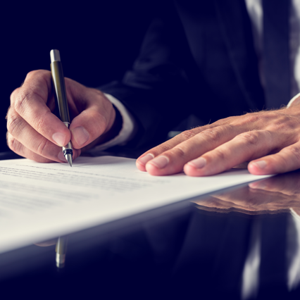 signing-legal-document-426x426